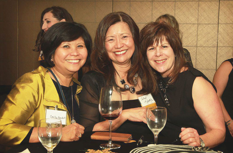 smiling ladies at happy hour after illuminating women conference