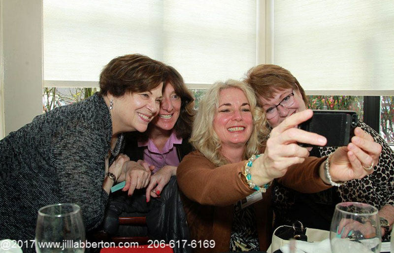 ladies taking a selfie at illuminating women spring empowerment conference woodinville seattle area