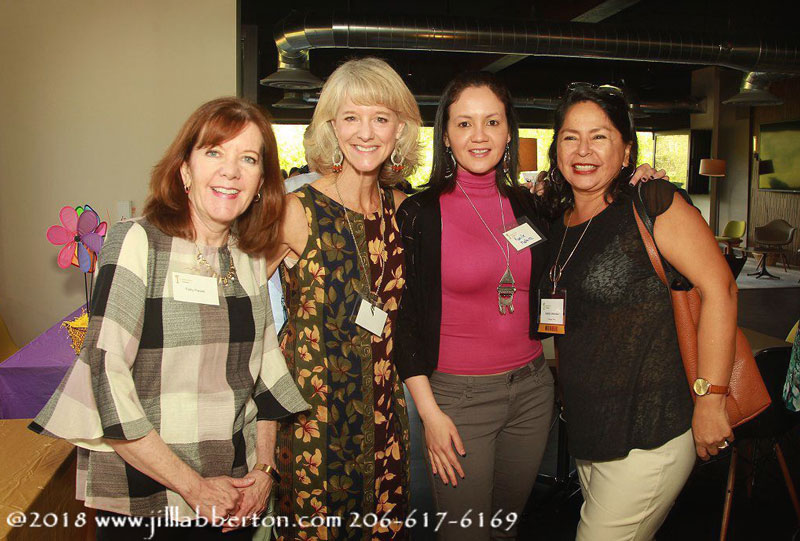 diverse group of smiling ladies gathering at illuminating women conference